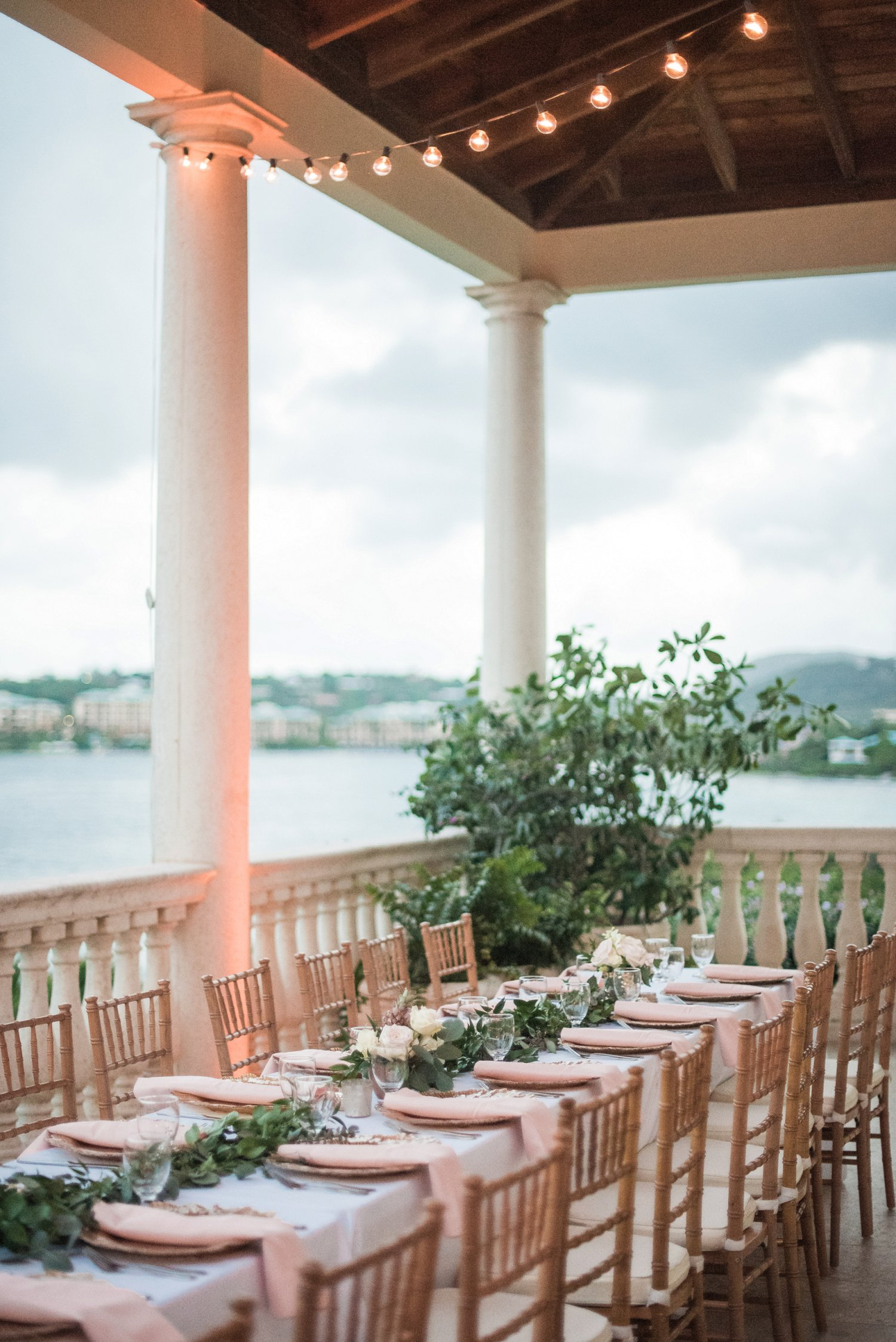 Wedding reception with blush napkins and gold chargers at Villa Serenita, St. Thomas, USVI