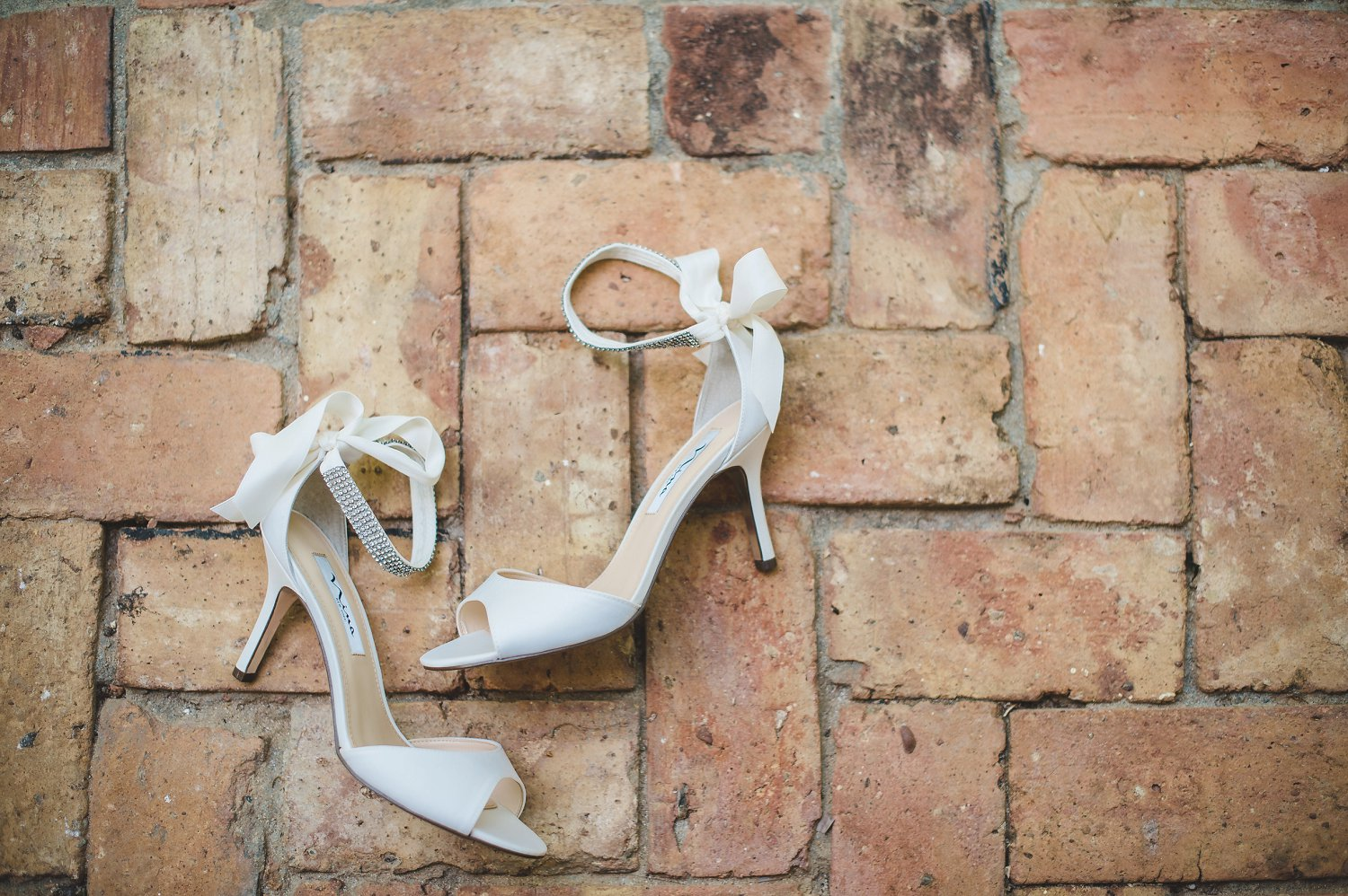 Nina brand ankle strap ivory/white silk satin d'orsay style wedding pumps for destination wedding.