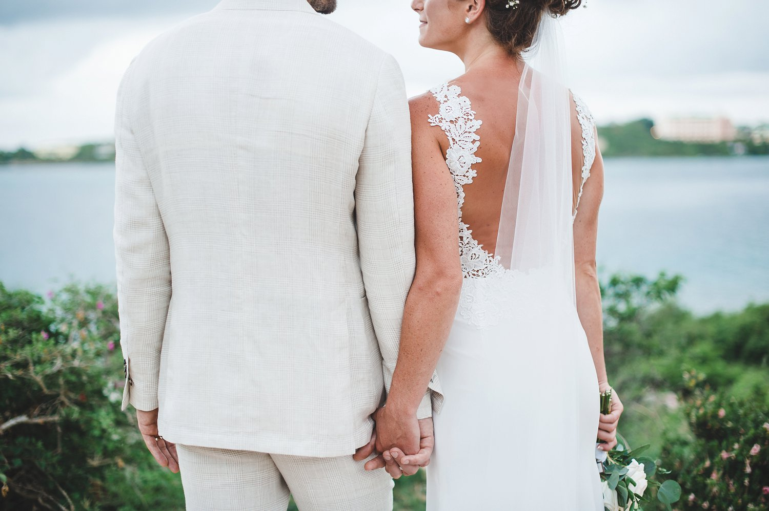 Wedding couple overlooks the ocean view at destination wedding in St. Thomas