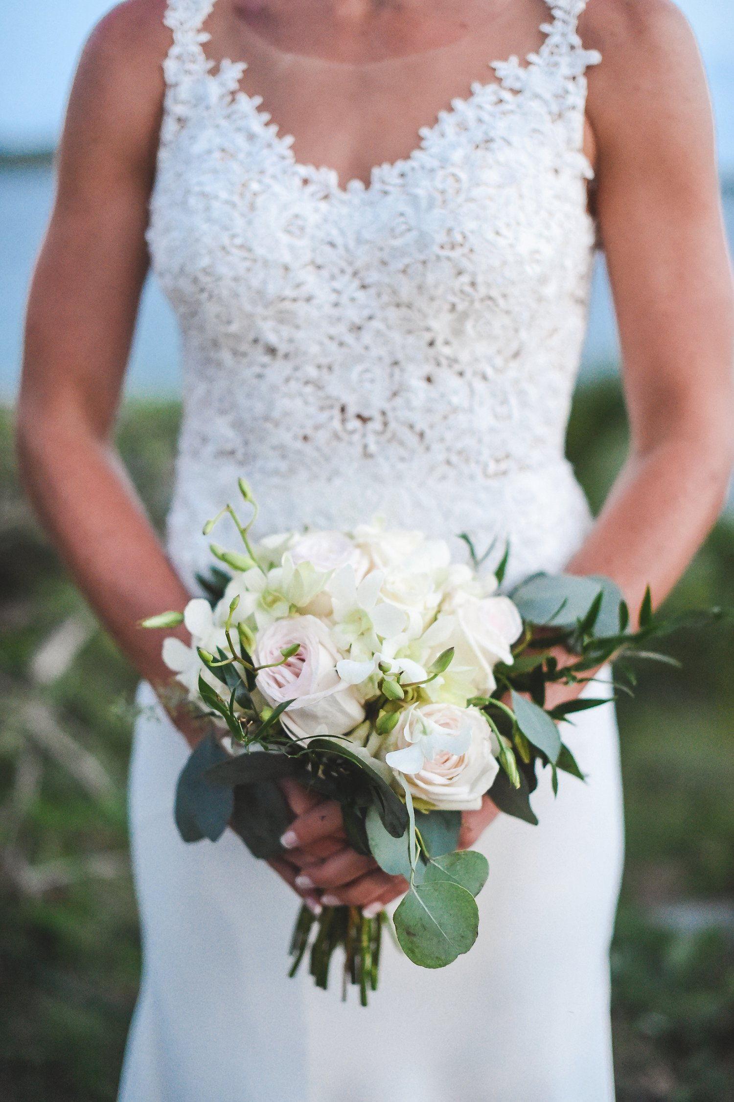 Blush roses and white/ivory dendrobium orchids bridal bouquet.