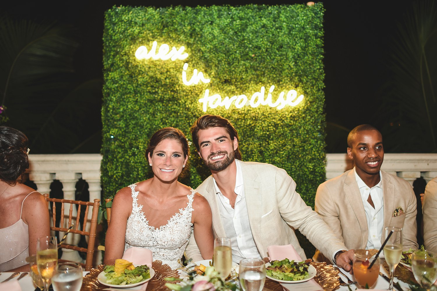 Bride and groom with neon sign at wedding reception in St. Thomas
