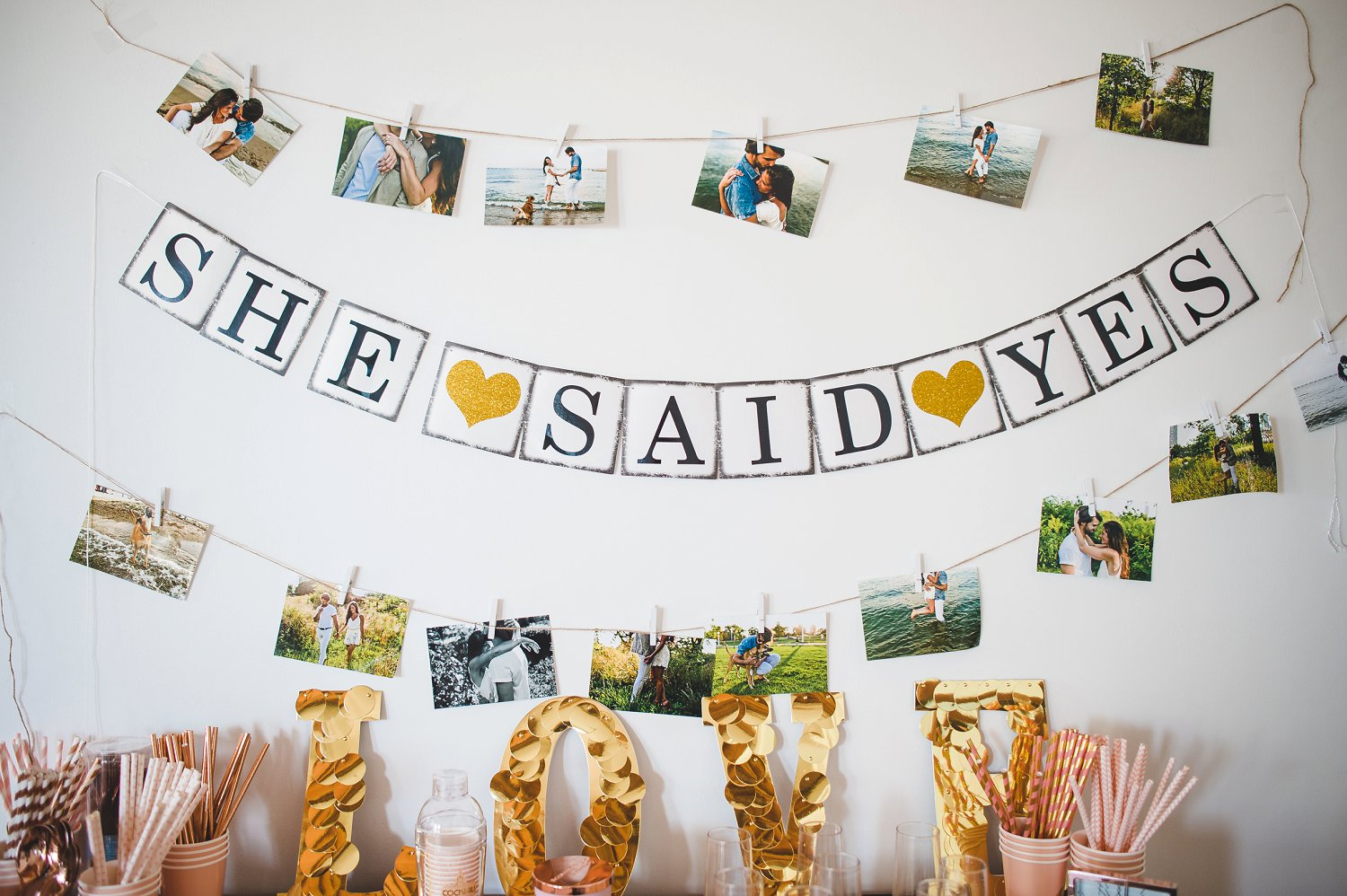 Getting ready wedding decor ideas with 'she said yes' bunting banner and bridesmaids getting ready cocktail and mimosa bar.