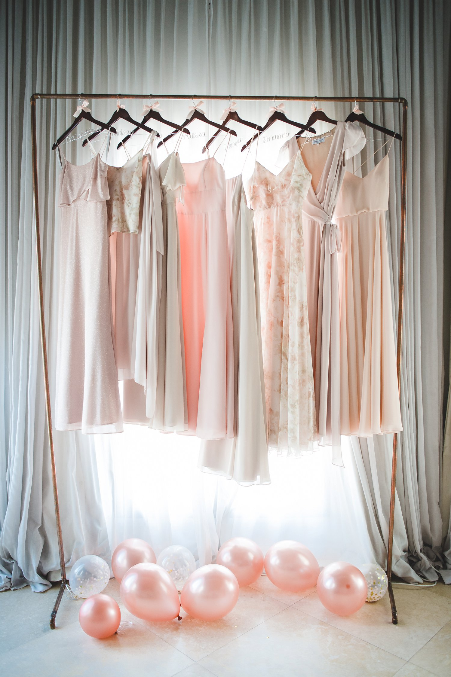 Mismatched bridesmaids dresses ideas in ivory, blush, neutral for destination wedding