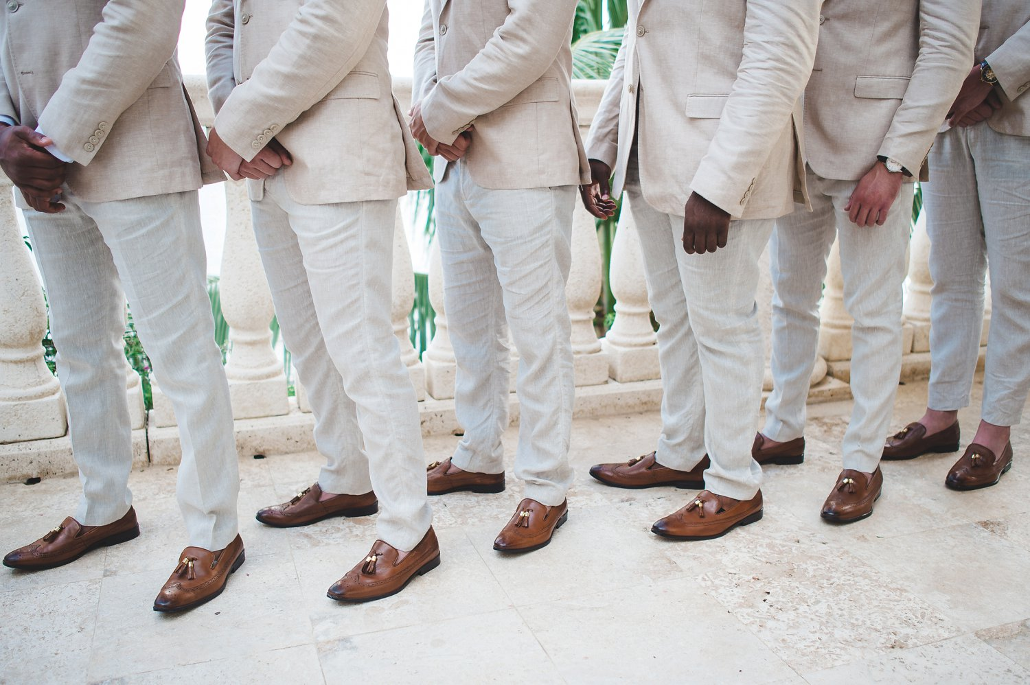 Stylish leather shoes for groomsment with tan khaki suits at Caribbean wedding.