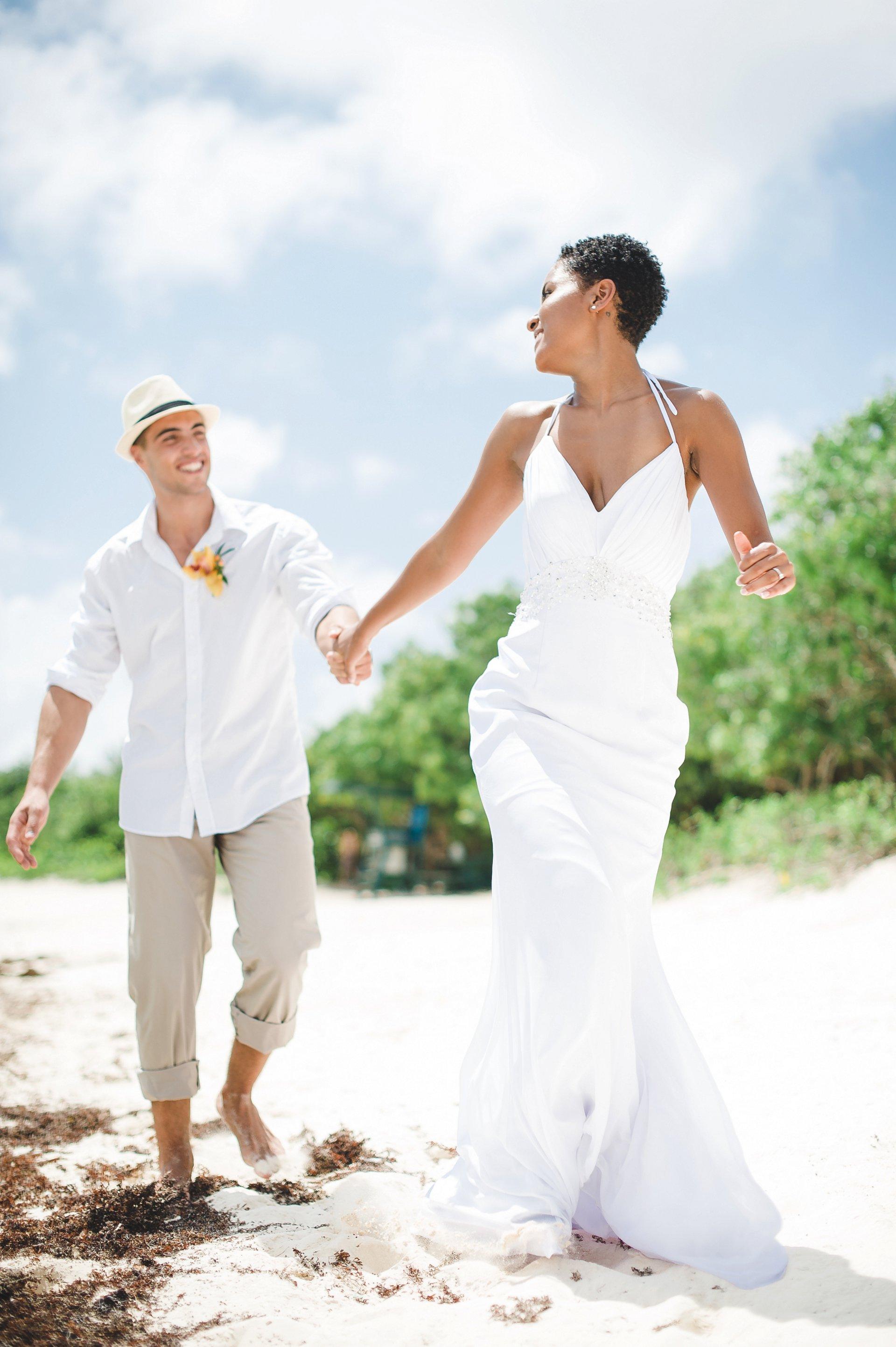 Elopement wedding couple runs down the beach at Lindquist Beach, St. Thomas