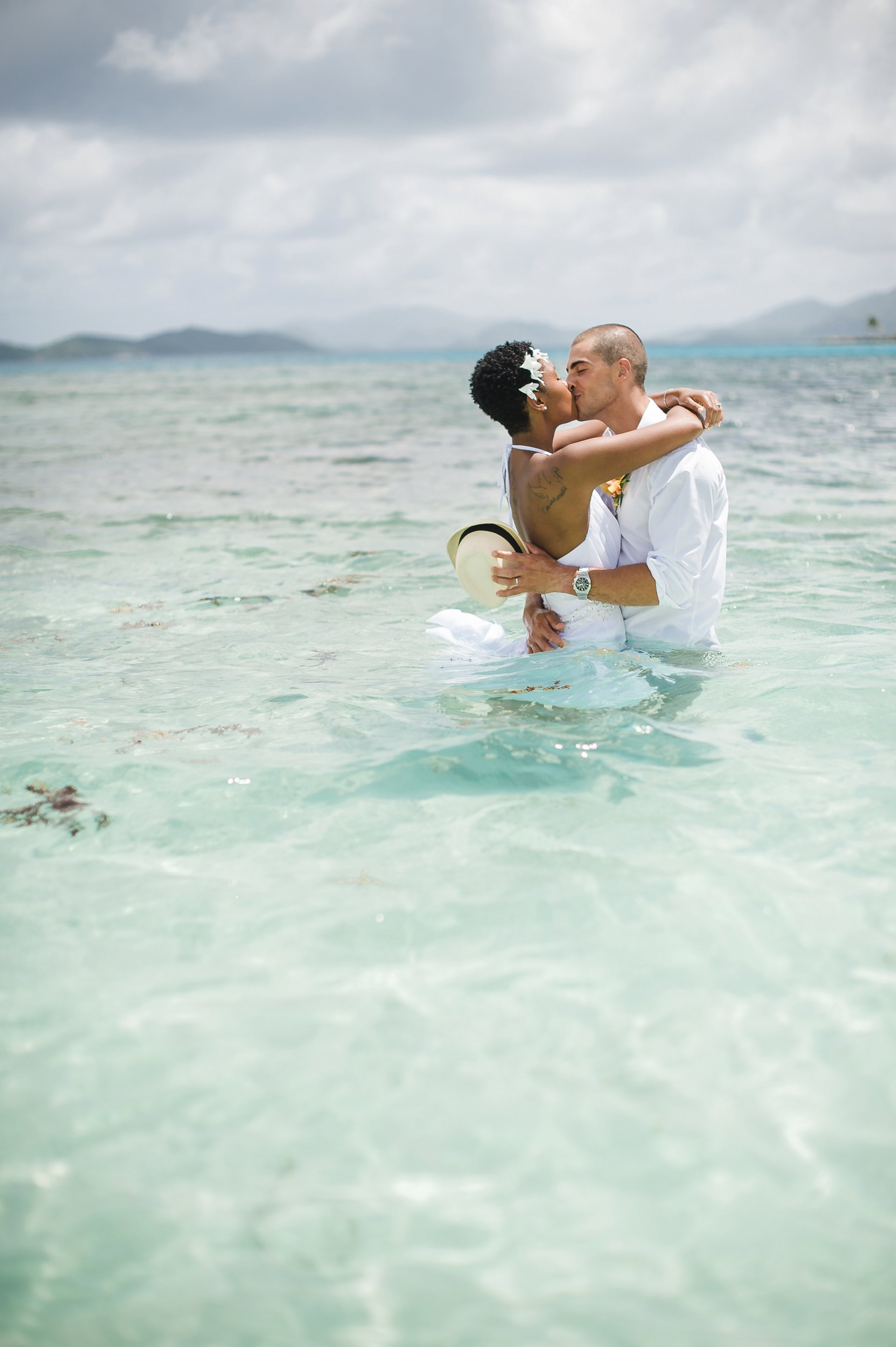 Trash the dress: couple gets in the ocean at destination wedding at Lindquist Beach, St. Thomas.