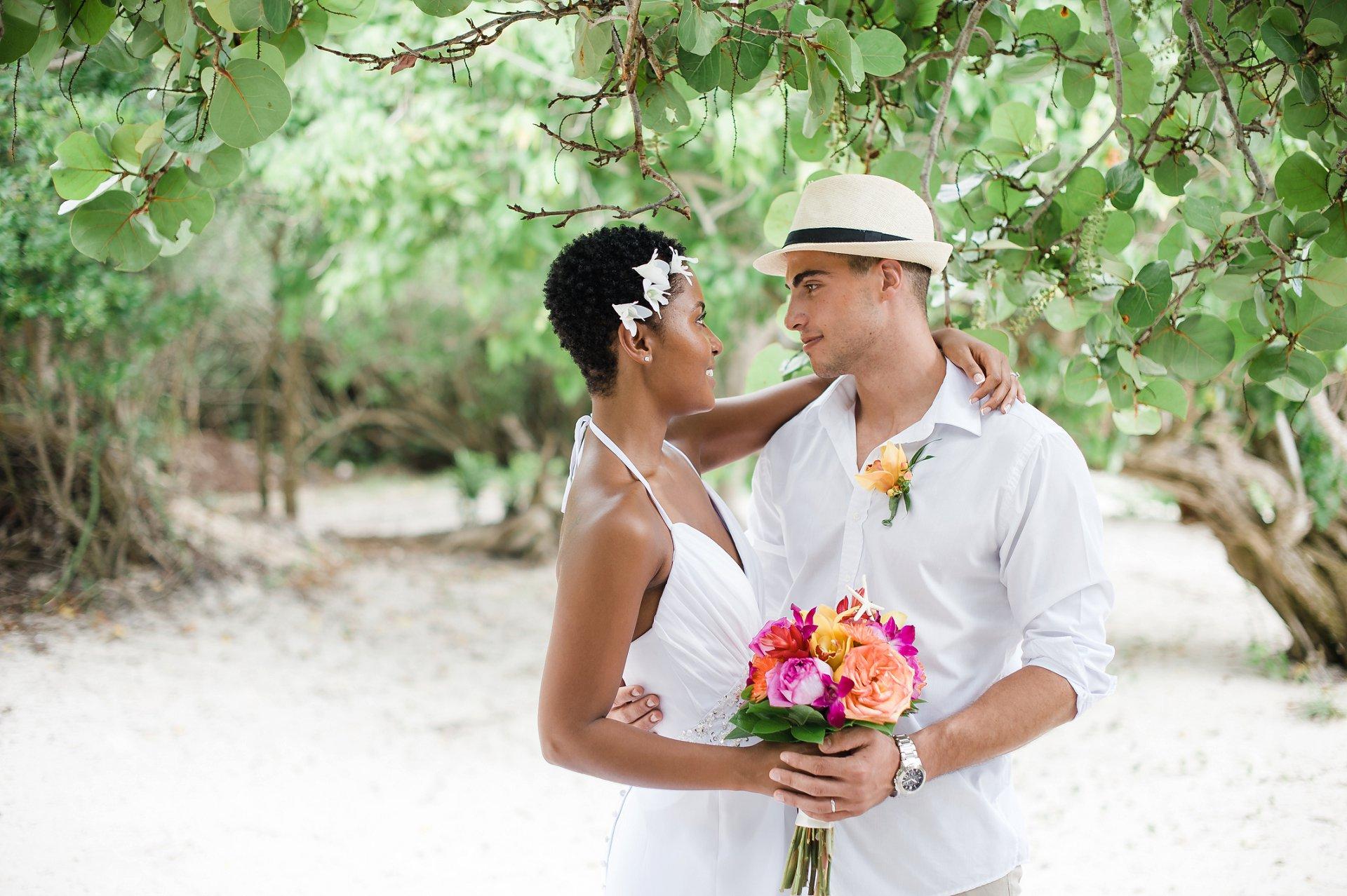 Bride and groom portrait under seagrape trees at Caribbean destination wedding