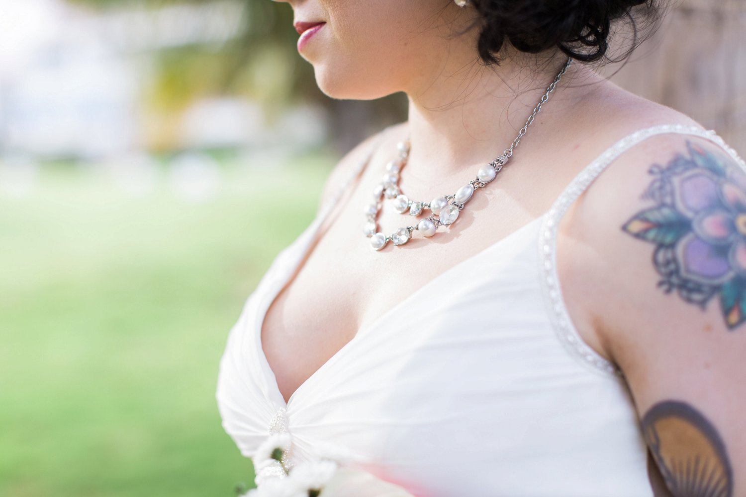 Chunky necklace worn by bride.