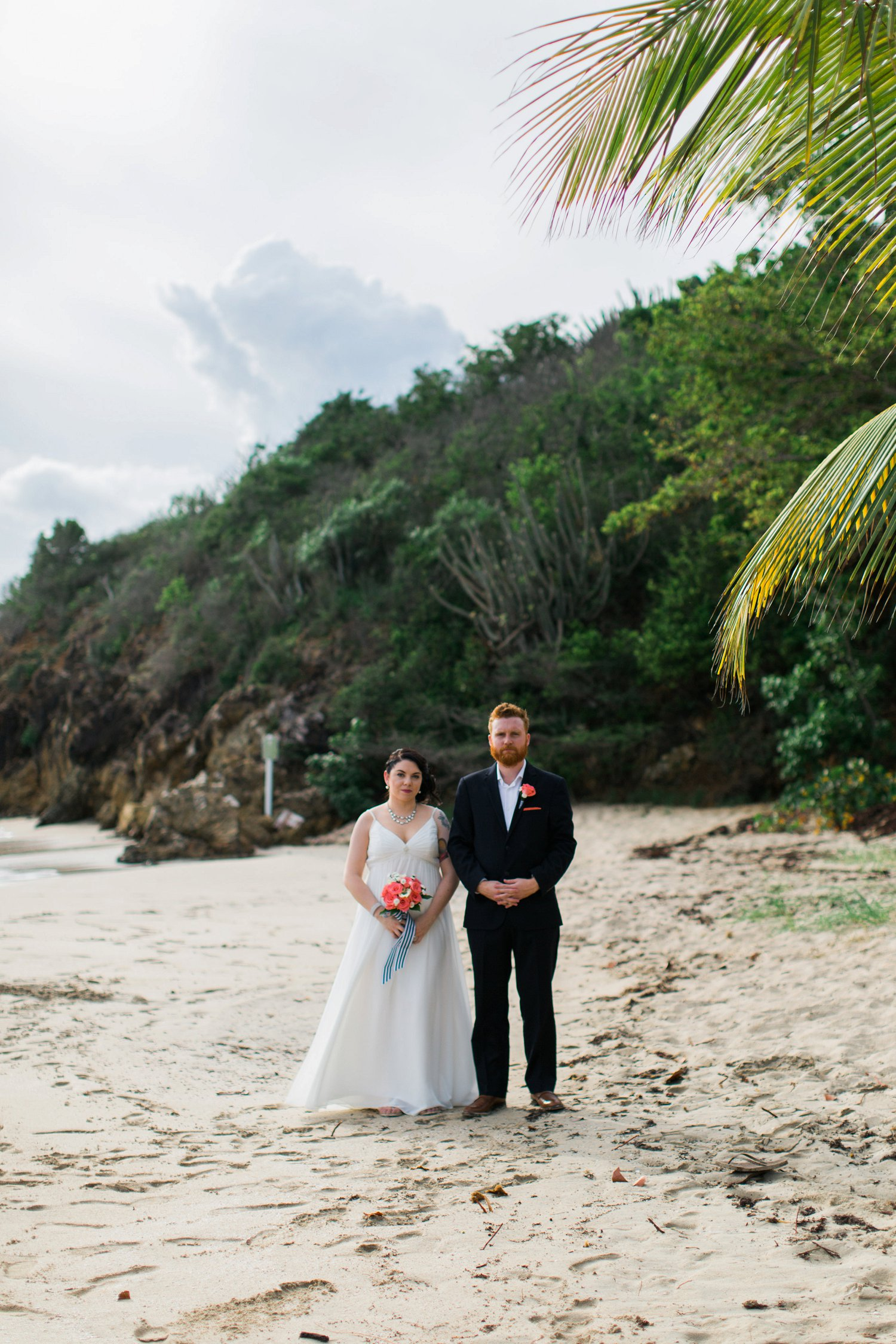 Classic bride and groom beach portrait.