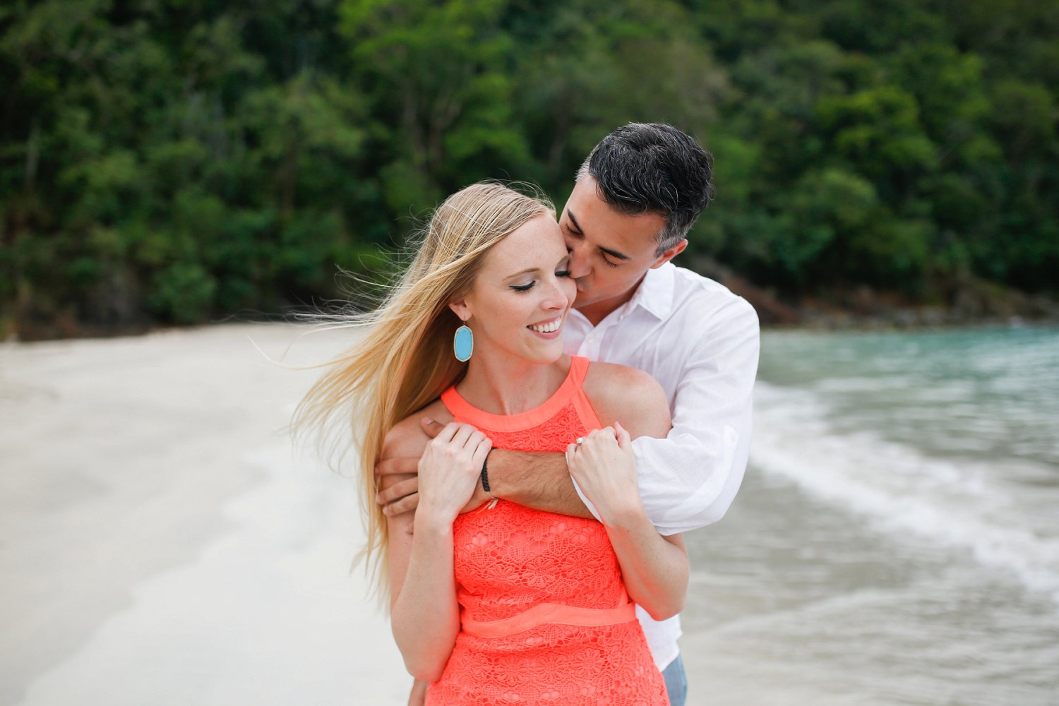Engagement photography session at Magens Bay Beach planned by Blue Sky Ceremony.