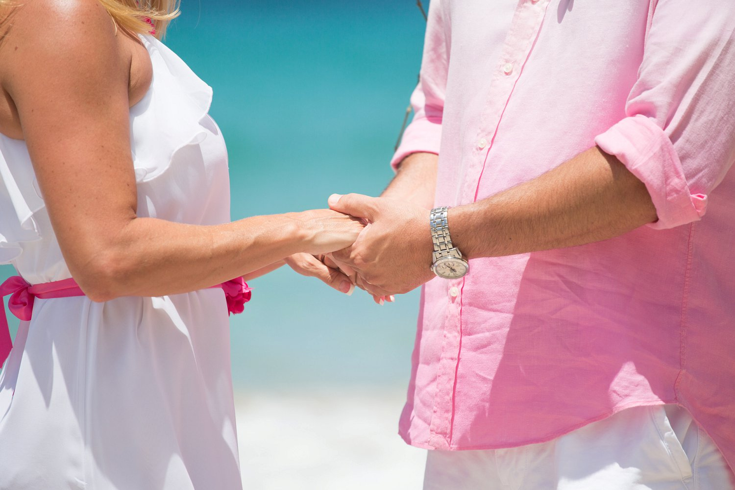 Exchanging rings at destination vow renewal.