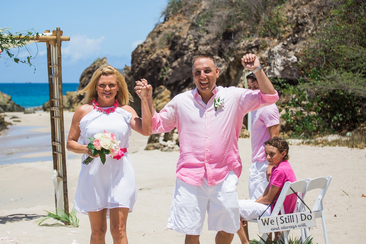 This couple just celebrated their 20 year vow renewal on a cruise to St. Thomas with a ceremony on the beach with Blue Sky Ceremony.