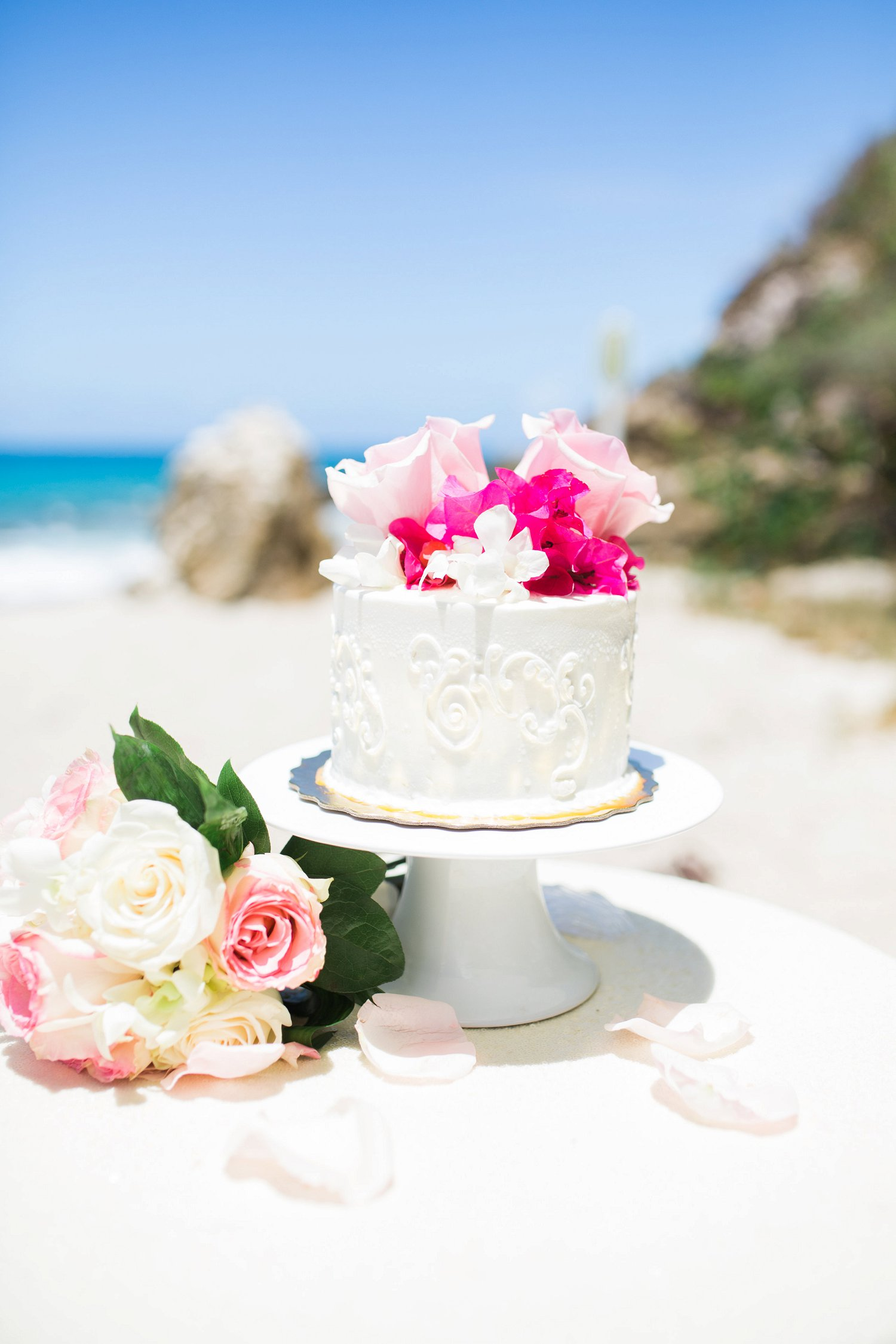 Mini wedding cake for beach vow renewal ceremony.