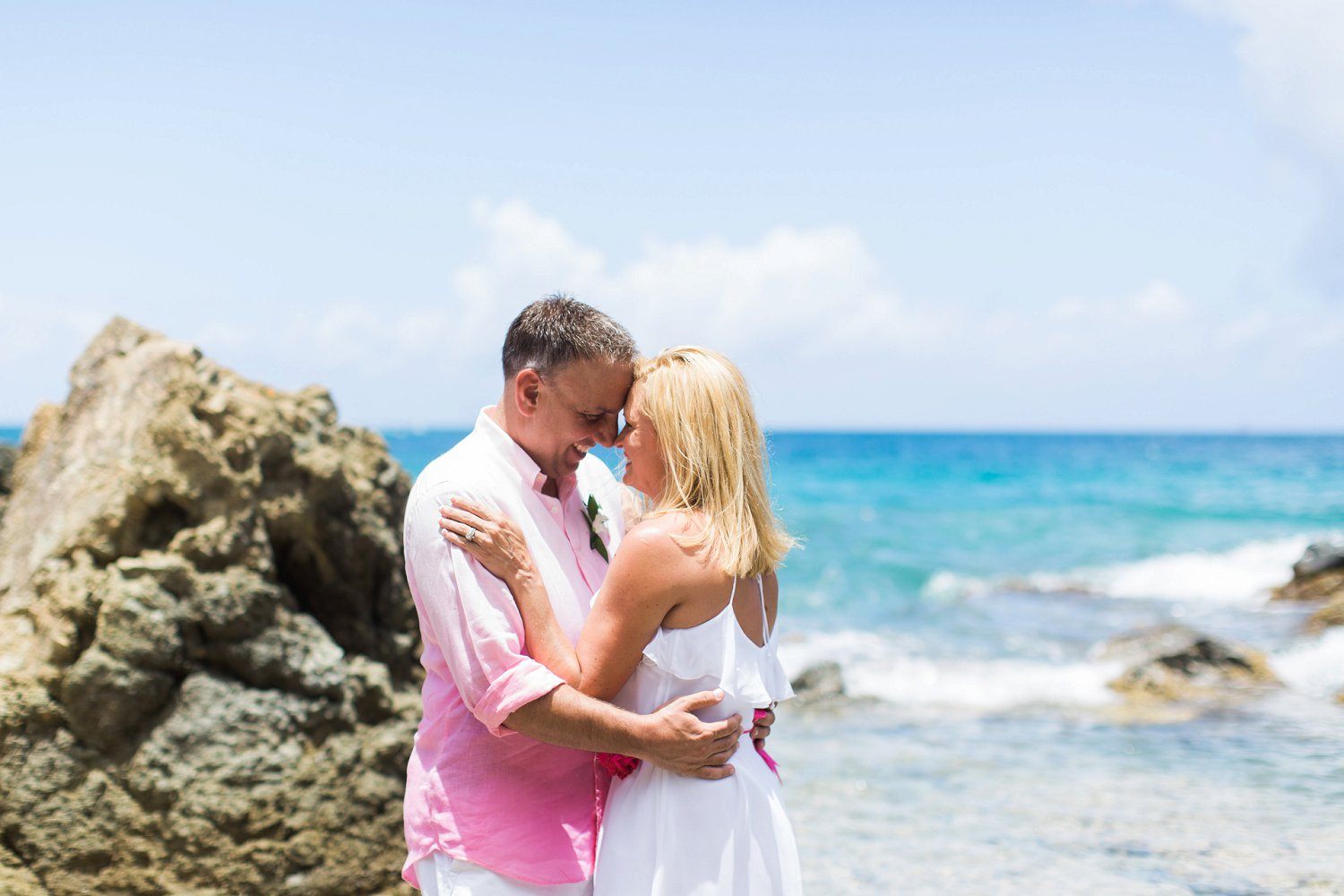 Beach vow renewal couple's portrait.