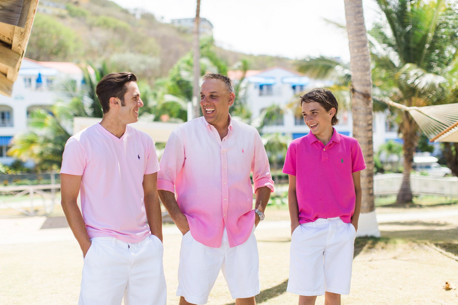 Groom and his sons all wearing pink await the bride for vow renewal ceremony.