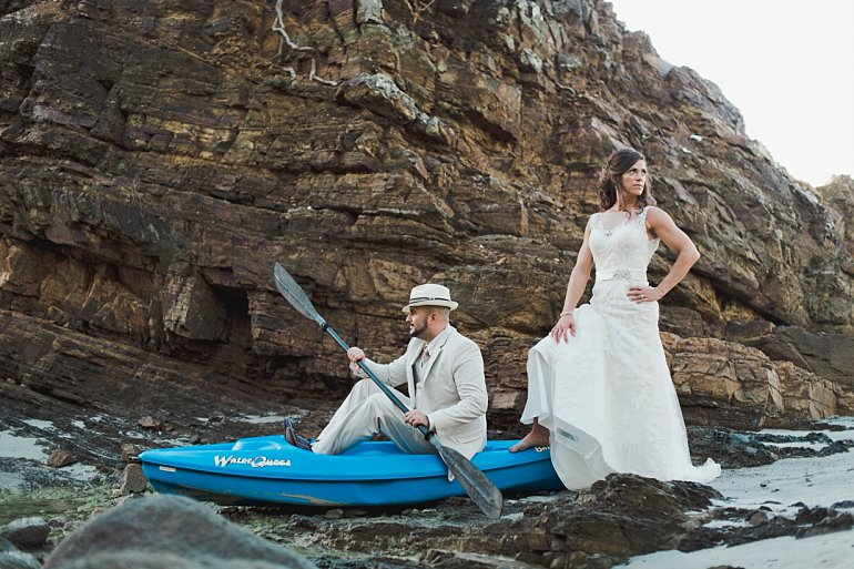 Wedding couple poses for photo in Kayak in St. Thomas