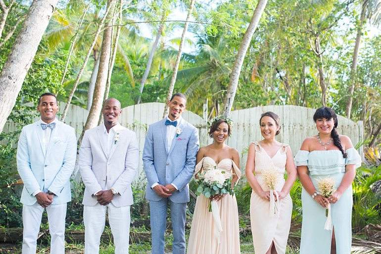 Wedding party in mismatched neutrals and pastels at tropical beach wedding in St. John