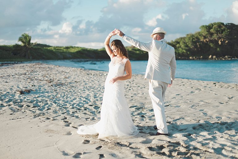 Couple has first dance on the beach after their wedding in St. Thomas