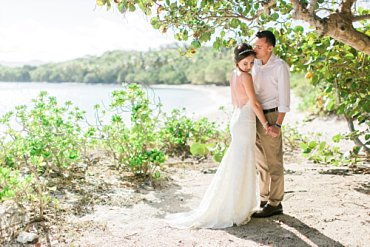 Couple gets married at destination elopement wedding at Lindquist beach, St. Thomas, with Blue Sky Ceremony