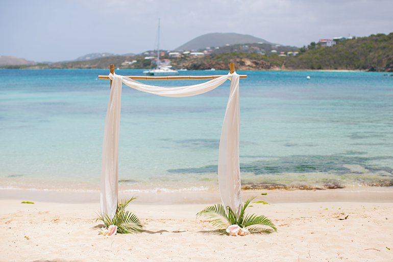 Bamboo wedding arch at Secret Harbor Beach, St. Thomas destination wedding planning packages