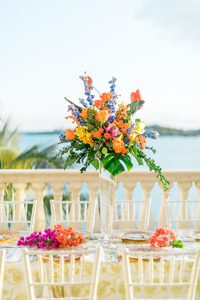 Tall tropical color and tropical flowers centerpiece for destination wedding in St. Thomas