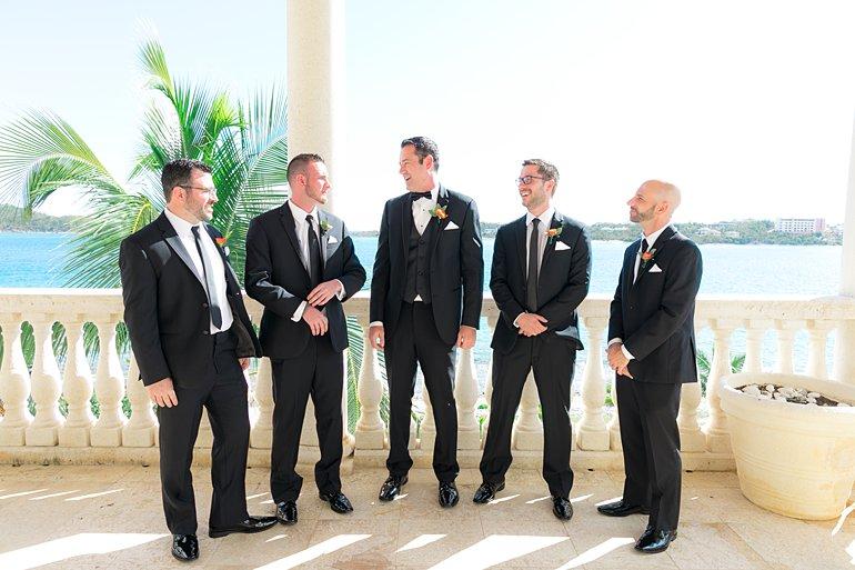 Groom and groomsmen in tux tuxedo and ties