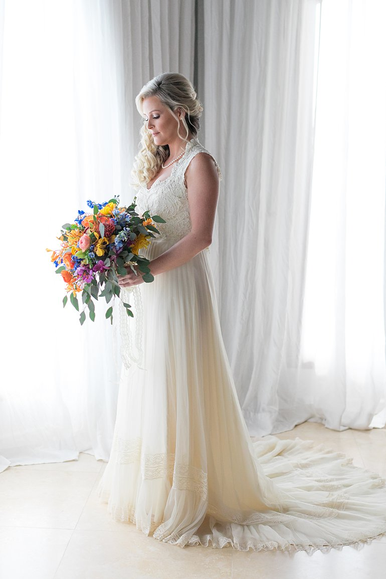 Bride wearing vintage lace and chiffon wedding gown that belonged to her mother with huge bouquet