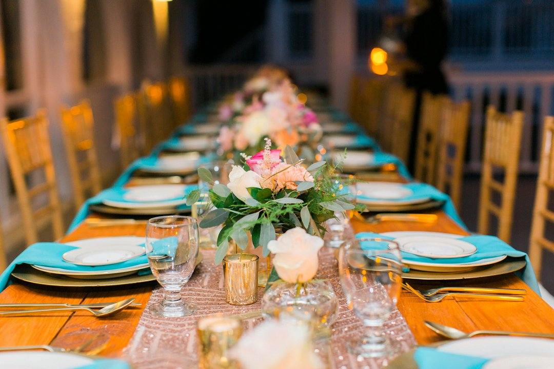 Rose gold and turquoise/aqau wedding reception table set up by wedding planner: Blue Sky Ceremony, St. Thomas, USVI