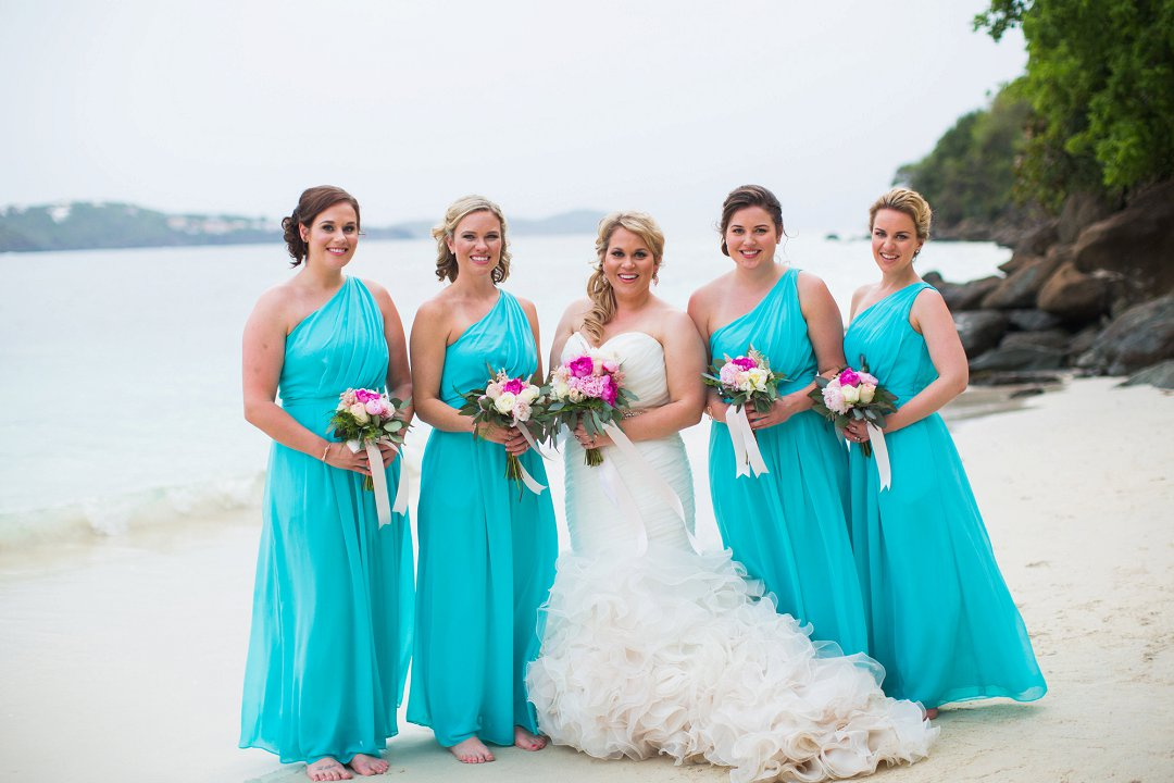 Bride and bridesmaids in turquoise aqua bridesmaids dressed with bright pink peonie bouquets and flowers for beach wedding at Sand Dollar Estate, St. Thomas, USVI