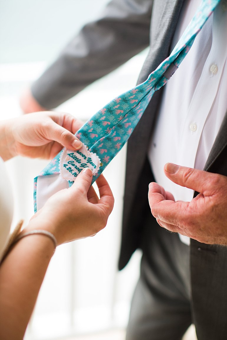 Bride affixes wedding tie patch for her father's tie - Always your little girl