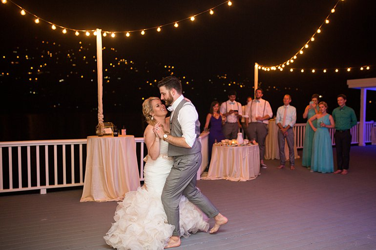 Bride and groom enjoy their first dance at Villa Rental Venue: Sand Dollar Estate