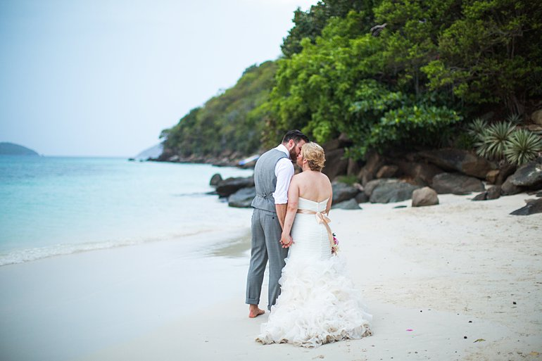 Bride and groom walking down the beach at wedding in St. Thomas by Savanah Loftus Photography.
