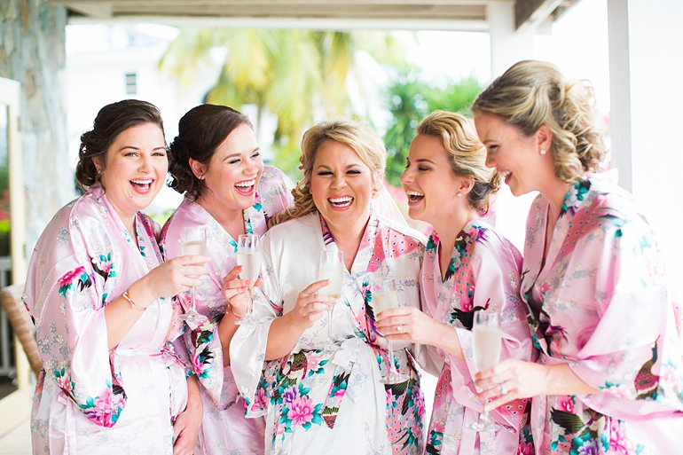 Bride and bridesmaids in matching robes getting ready for Sand Dollar Estate Beach Wedding