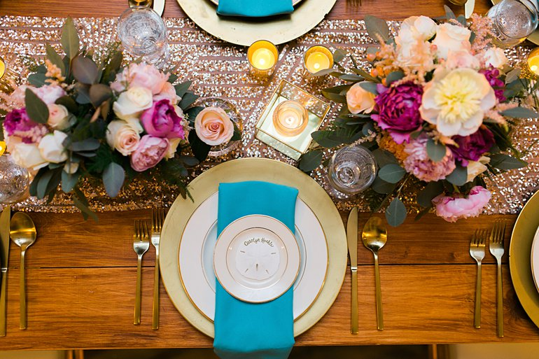 Sequin rose gold and turquoise napkins on wood table for destination wedding at Sand Dollar Estate Villa, St. Thomas, Virgin Islands