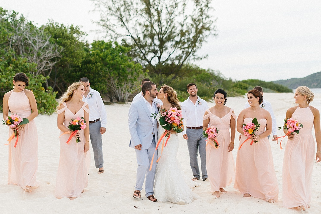 Light pink peach and gray beach destination wedding party attire.