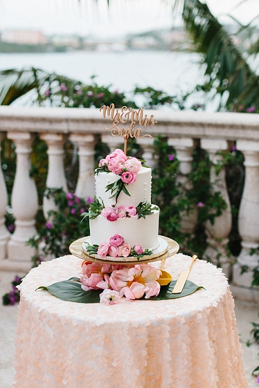 2 tier cake with pink ranunculus and buttercream frosting from St. Thomas wedding bakery.