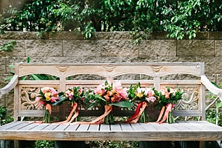 Peach and pink tropical bride and bridemaids bouquets