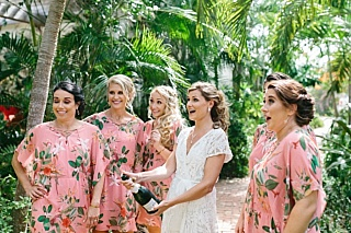 Tropical print bridesmaids gettinng ready robes for tropical wedding