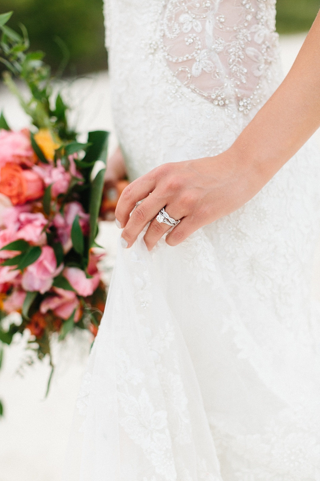 Beautiful must have wedding photograph of bride with wedding ring and bouquet