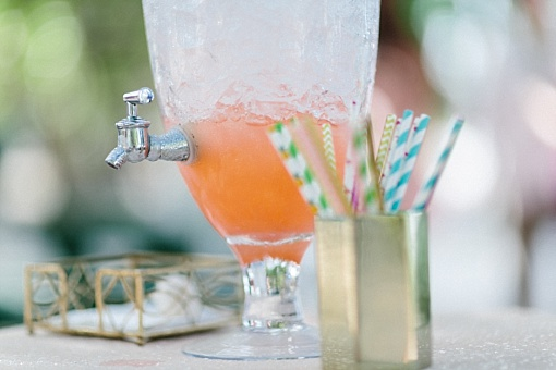Rum punch in glass apothecary style beverage dispenser for destination wedding in St Thomas